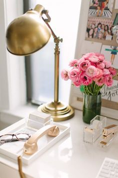 pretty desk. gold lamp. lucite and white accessories