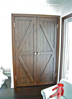 Reclaimed wood barn doors built for a girls room. Shown As:Solid reclaimed Douglas FirFinish: Dark Walnut with a flat lacquerHardware and hinges supplied by cli
