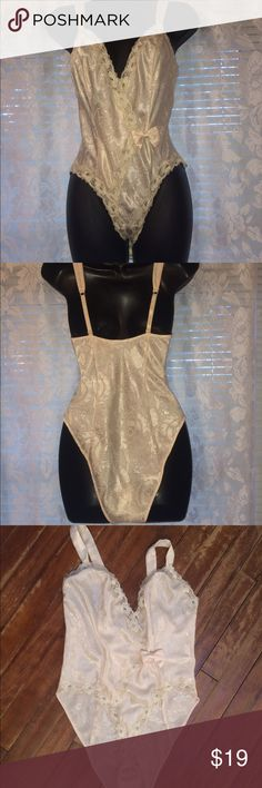 Vintage lingerie Satin Teddy romper body suit 80s Sorry- not taking offers on this item.  Bundling discount available.  Priced to sell.  Non smoking home-all sales final. Thanks!--This is 80s vintage Victoria's Secret-- thicker satin snap crotch Ivory with bows.  No flaws to report.  Adjustable straps.  Thick straps.  Pattern in the satin. Excellent. Vintage Victorias Secret Intimates & Sleepwear