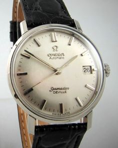 OMEGA Wrist Watch 1970 -plain, simple off white dial on stainless -  but very cool!