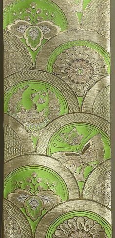 "Japanese Fukuro Obi  12""x 156"" (showing a 12""x 94"" decorated section)  Gold & silver brocading on green silk. Cranes, butterflies, mums, & paulownia leaves.  The metallic brocading in this obi is more gold than the photo suggests, w/ more ""sparkle."" Excellent condition $ 245"