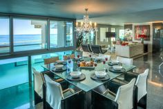 Clifton Rocks is a luxury self-catering holiday apartment in Clifton with 3 bedrooms. Outdoor Dining, Dining Area, Dining Table, Cape Town Holidays, Open Plan Bathrooms, Clifton Beach, 2 Twin Beds, Shared Rooms, Holiday Apartments