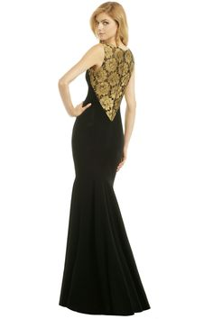 Meg showed me this very neat site: Renttherunway.com.   It has lots of beautiful designer gowns to rent at super-reduced prices.  Its a great option (i think) if you thinking buying a formal gown is pointless.  This is the Theia Golden Blossom Gown ($75) :)