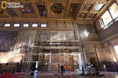 Scaffolding over Vasari fresco where holes are being drilled