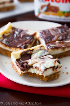 Creamy cheesecake bars on a simple graham cracker crust with a thick Nutella swirl.