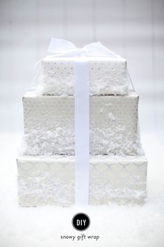 DIY snow gift wrap: http://www.stylemepretty.com/living/2014/12/18/diy-snowy-gift-wrap/ #SMPHolidays