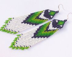 Native American style colorful fringe earrings - shoulder dusters. These wonderful dangle earrings are made of white, light green, green, dark green and black seed beads.  Silver plated ear wires.  Length approximately (including ear wires) - 7.7 inches (19.5 cm)