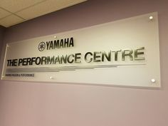 "Custom frosted acrylic lobby signs with 3D raised letters for ""YAMAHA"" - Since 1887, when it began producing reed organs, the Yamaha Corporation in Japan (then Nippon Gakki Co., Ltd.) has grown to become the world's largest manufacturer of a full line of musical instruments, and a leading producer of audio/visual products, semiconductors and other computer related products, sporting goods, home appliances and furniture, specialty metals, machine tools and industrial robots."