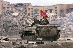 Russian BMP driving through Capital city of Grozny 1996.