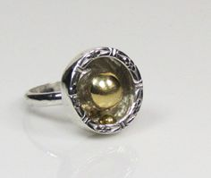Sterling silver and brass kinetic ring by RadiantOriginals on Etsy, $45.00