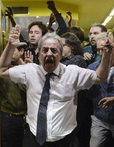 UP IN ARMS: People shout slogans during a demonstration by incensed Spaniards to protest against severe anti-austerity measures. (AFP