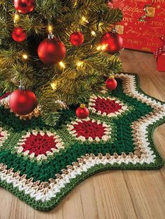"""A circular strip of joined pentagon granny motifs becomes a completed tree skirt by adding deep crochet borders to the inside and outside edges. The result is pure vintage charm! Includes written instructions only, plus an assembly diagram. This e-pattern was originally published in Crochet Comfort & Joy. Size: 32"""" in diameter, from point to point. Made with medium (worsted) weight yarn and size I/9/5.5mm hook. Skill Level: Easy"""