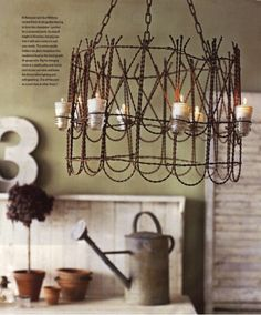 reused garden fencing as a chandelier...interesting! reduce-reuse-recycle