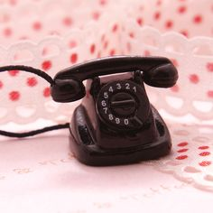 3,90 Measures 15mm  A miniature antique telephone made in the 60s.    Excellent for kitch jewelery crafting, accessories and other sort of decorations.