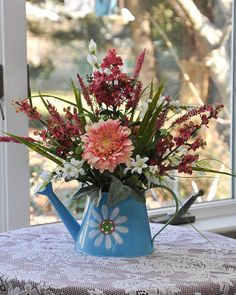 The 319 best spring flowers images on pinterest in 2018 floral spring floral arrangement blue watering can mightylinksfo