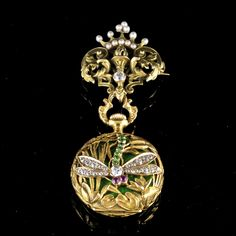 ART NOUVEAU LADY'S PENDANT WATCH BAILEY BANKS & BIDDLE CO. Antique Lady Pendant Watch Art Nouveau, signed Bailey Banks & Biddle Co. Philadelphia. Watch by Patek Philippe with anchor escapement no. 1200, completely set with rubies. High relief gold and orient pearls. Inner case green translucent guilloche enamel, a jour gold openwork overcase consisting of a dragonfly set with demantoids, diamonds and rubies.