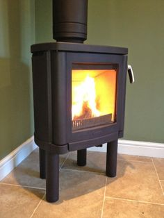 """""""Contura 53"""".  A stove with a curved back specifically designed to fit in the corner of a room.  Connected to a twin wall insulated flue system. - From: Fahrenheit Stoves Ltd – Wood Burning Stoves In Yorkshire :-("""