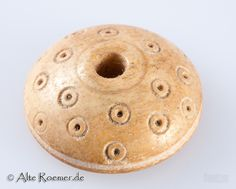 Bone spindle whorl, Germany. 6th Century AD to 8th Century AD. D / H 20/8 mm.