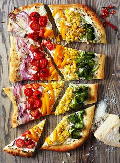 This rainbow pizza recipe would be delicious for a meatless monday, a weeknight meal, or dinner parties.  Rainbow food recipes have become more popular lately, but not all of them are very natural. This tops the list of the ideas for a tasty vegetarian dinner. So easy too!