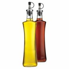"""Glass bottle with a pour spout and rubber stopper.  Product: Set of 2 bottlesConstruction Material: Glass and metalColor: ClearDimensions: 10"""" H x 3.25"""" Diameter each"""