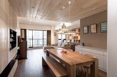 Apartments:Modern Apartment Living Spaces With Breakfast Table With Bench Along With Sweet Pendant Lights Also And White Kitchen Cabinets And Open Shelving Plus Sofas And Tv Cabinets And Wood Flooring Then This Amazing Wood Decoration Modern Apartment Design with Creative Wood Decorations