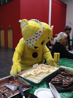 Pudsey tucks into some cake at the Derby Road campus. 2013.