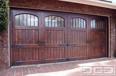 Spanish Style Garage Door with Iron Window Grills - Heavy ring knockers, beefy i.