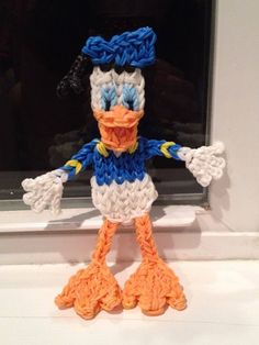 DONALD DUCK. Designed and loomed by Kelly Serrell Motta on the Rainbow Loom. (Rainbow Loom FB page 02/26/14)