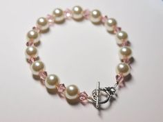 Glass Pearl and Swarovski Crystal Bracelet. Swarovski Crsytals come in a huge range of colors. This would make a wonderful bridesmaid gift! All the supplies to make this bracelet can be found at www.theartisticendeavor.com!