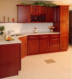 Cherry Shaker Kitchen Cabinets cherry kitchen with light countertops dan likes these cabinets