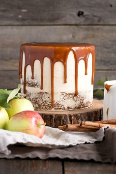 Caramel Apple Cake! A spice cake made with diced apples, paired with a caramel buttercream, and caramel drizzle. | livforcake.com