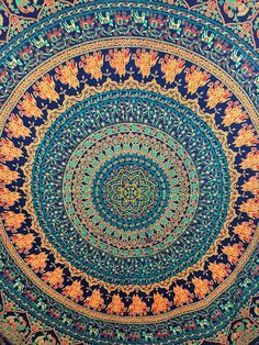 """Made from 100% light-weight, breathable cotton fabric, the medallion tapestry is screen- printed by hand in beautiful intricate motifs. Instantly transform your room, dorm or apartment with this cost effective and versatile fabric. Use it as a bedspread, throw, wall hanging, table cloth or for a variety of sewing and DIY projects. Size: 94*82 """" (inches approx) Materials: Cotton, Screen printed by hand Color: Earthy tones of blue and beige (colors may very slightly vary due to the nature..."""