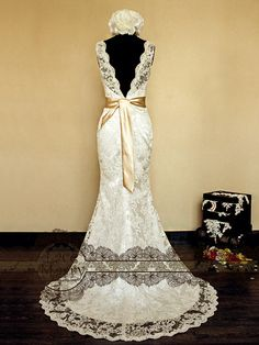 Deep V-Cut Back Vintage Style Lace Wedding Dress Features Illusion Neckline and Satin Sash. $252.00, via Etsy.