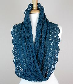 This lovely lace infinity scarf adds a touch of elegance to your outfit. It is one of four patterns included in the Lovely Lace Quartet pattern set.