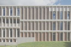 The façade is a simple grid in brick and pre-cast concrete.