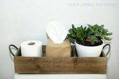 Bathroom holder for toilet paper tissues and I would do baby wipes or more toilet paper instead of a plant