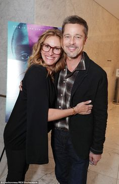 Two's company: Brad Pitt, 52, made his first official appearance since his split from Angelina Jolie when he attended a screening of Moonlight in Los Angeles on Tuesday with Julia Roberts