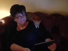Juliet loves to lokk at the ipad while on my shoulder