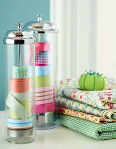 Ideas to organize your sewing room :: use a soda straw dispenser as ribbon storage