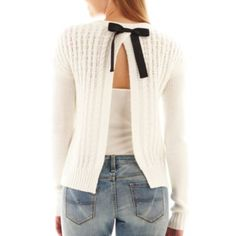 Make an stunningly chic entrance and exit in our soft, cable knit sweater featuring a bow-back design.