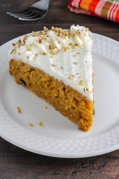 Soft, fluffy, and flavorful pumpkin cake is topped with cream cheese frosting and chopped nuts. This recipe is a Fall favorite.