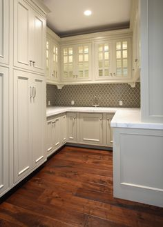 Markay Johnson Construction - back splash, white cabinets.