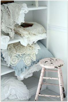Shabby chic into your linen closet. Love the rustic white stool. #interior #decor #design