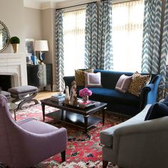 more formal, clearly, than your room, but note the color richness with the blue sofa and red oriental (and geometric curtains too)