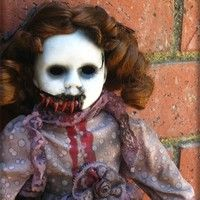 Creepy doll to put on your porch for halloween. Take any regular doll.   Ingredients:  Pretty Doll  Fake Blood  White Paint  Black Paint  Ruber Bands    Directions: So first take the doll and paint its face white. Let dry over night. Now paint eyeballs black. you may need a few coats. put a little water on it to let it droop.  now take a knife and cut part of the dols face. use rubberbands and glue them like muscles. take fake blood and coat. drip fake blood on outfit. ALL DONE!