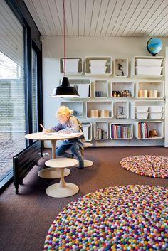 Playroom wall mounted cubbies textural rug modern globe