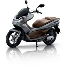 Honda PCX150 2014. Not a sport motorcycle and not suitable to be placed in this board [sorry]. But this is still my wishlist motorcycle.