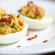 Bacon Deviled Eggs - LOVED these! (Don't forget to use week old eggs for easy peeling.) I used smoked paprika on top and added Siracha instead of Frank's Red Hot. Primal Recipes, Low Carb Recipes, Real Food Recipes, Cooking Recipes, Diet Recipes, Healthy Recipes, Avocado Deviled Eggs, Deviled Eggs Recipe, Bacon Avocado
