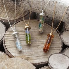 Carry the seasons with you with these beautiful terrarium necklaces.
