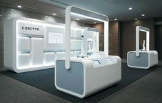 When exhibit house Hakuten Corp. was tasked with crafting this stand for Denso Corp.'s Cobotta, an arm robot designed for nonindustrial applications, it sought to create a setting that was inviting, encouraged exploration, and reinforced key Exhibition Stall, Exhibition Stand Design, Exhibition Display, Hall Design, Stage Design, Exibition Design, Counter Design, Showroom Design, Robot Design